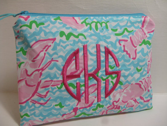 KaraMiaSofia has these makeup bags, and they are monogrammed as well! The shop also has some great bows too!